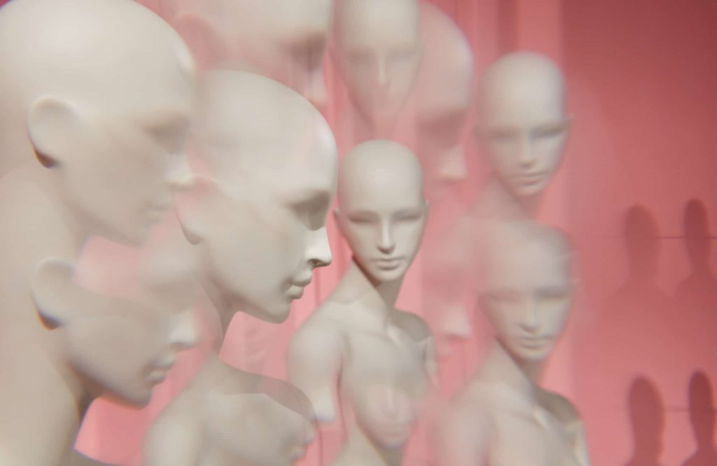 collection of Tribe female mannequin heads on a pink background