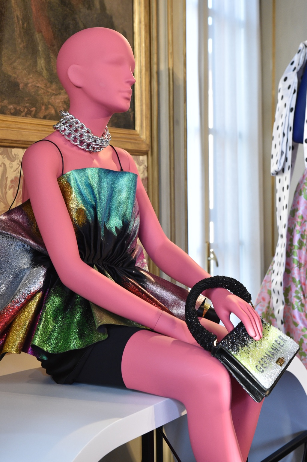 A pink seated female mannequin