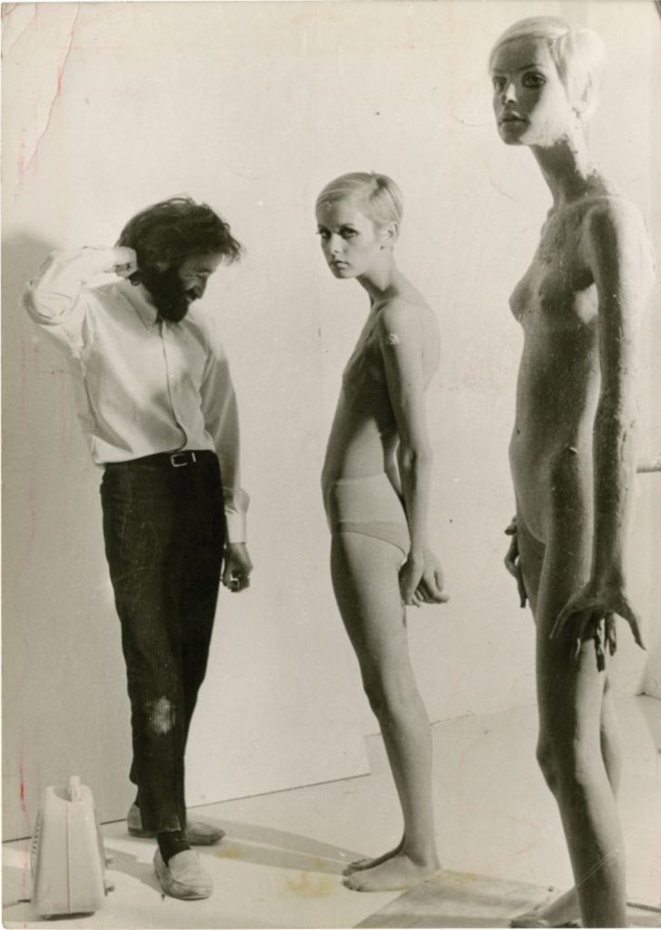 Sculptor John Taylor working with Twiggy in a sculpting studio