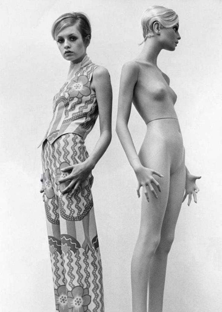 Twiggy in full length garment with her matching mannequin