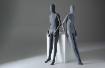 Male and female Sartorial mannequins leaning against a plinth